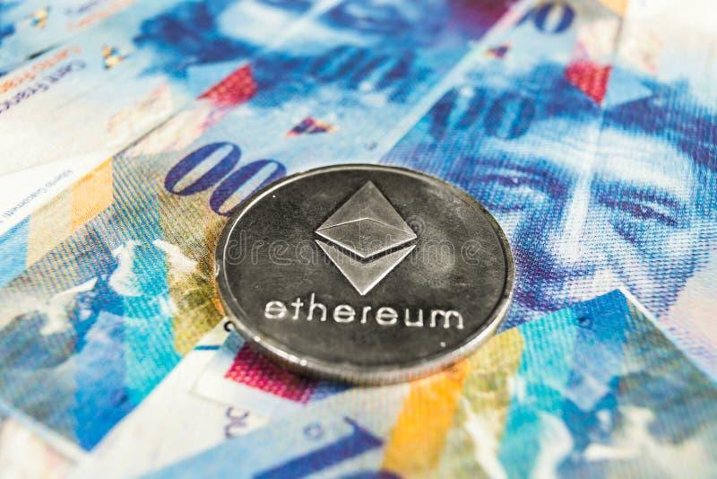 Crypto waluty pojęcie - Ethereum z frank szwajcarski walutą, Szwajcaria zdjęcie stock