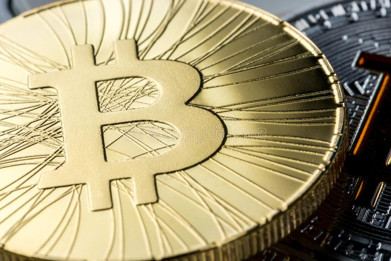 Cryptocurrency bitcoin coins. Gold bitcoin, macro view, virtual money and internet business concept royalty free stock photo