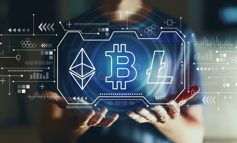 Cryptocurrency - Bitcoin, Ethereum, Litecoin met de jonge mens royalty-vrije stock fotografie