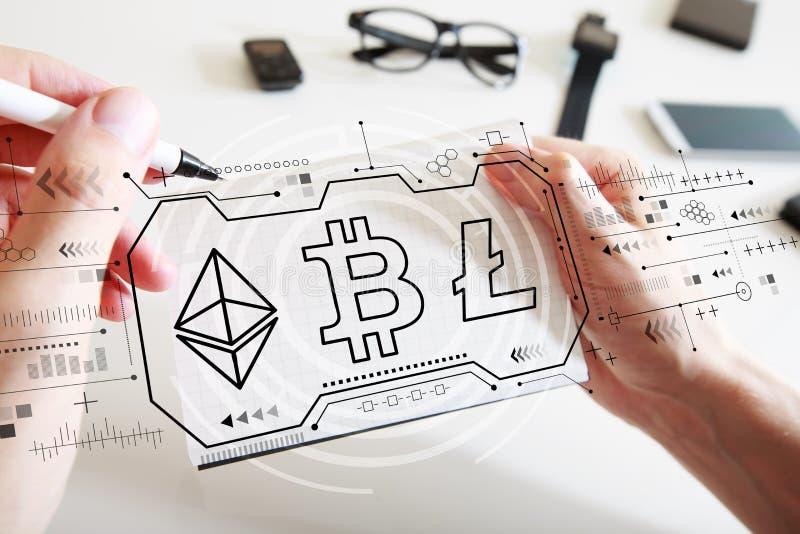 Cryptocurrency - Bitcoin, Ethereum, Litecoin met een notitieboekje royalty-vrije stock afbeelding