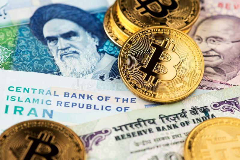 Cryptocurrency Bitcoin with Iranian Rial and Indian Rupee money. Bitcoin BTC Cryptocurrency coins on Iranian and Indian banknotes close up image. Cryptocurrency stock photos