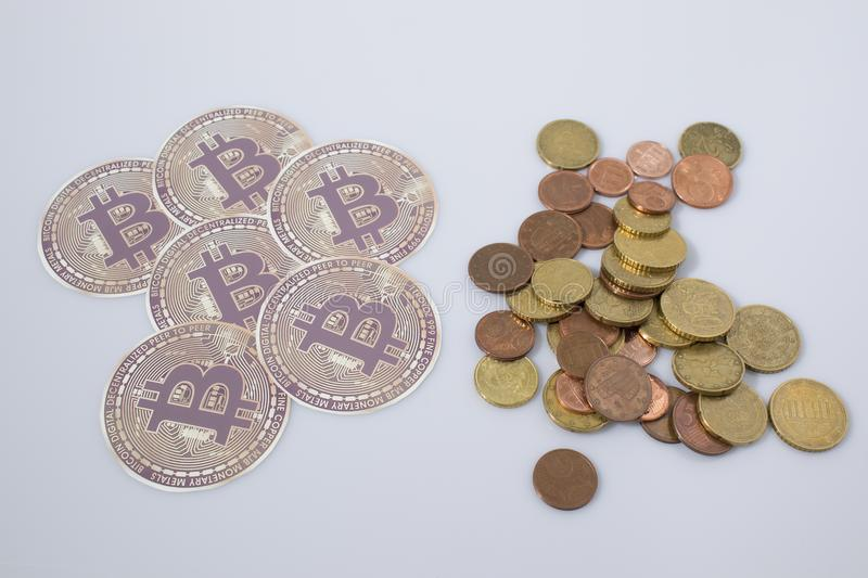 Cryptocurrency bitcoins and euro coins in a white background stock photography