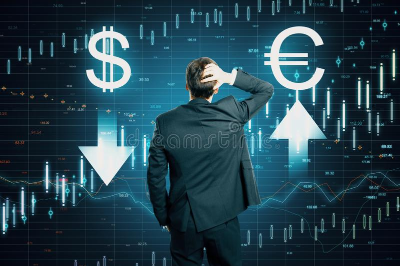Cryptocurrency and choice concept. Back view of young businessman thinking about digital currency signs on forex chart background. Cryptocurrency and choice royalty free stock image