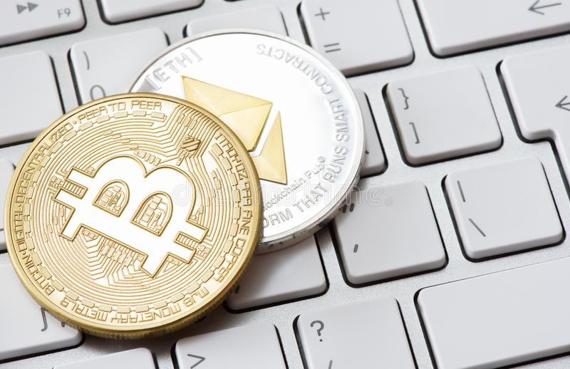 Cryptocurrency coins - Bitcoin, Ethereum stock photo