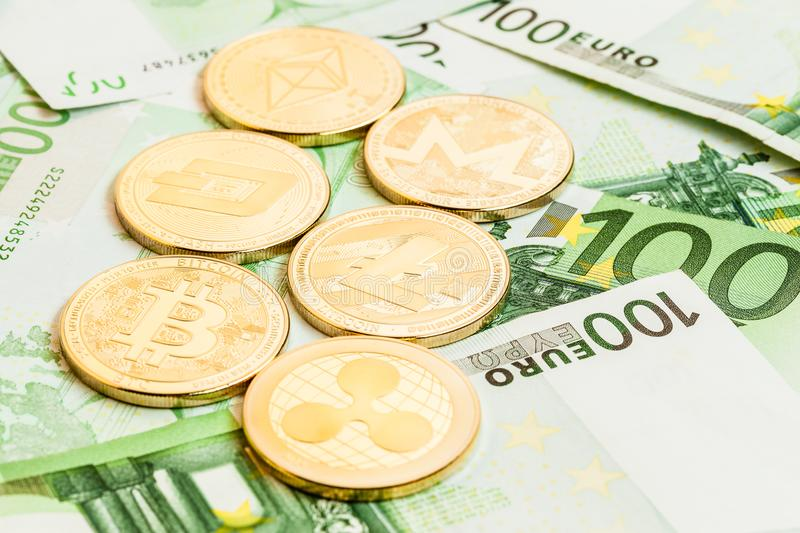 Cryptocurrency collection on euro bills stock images