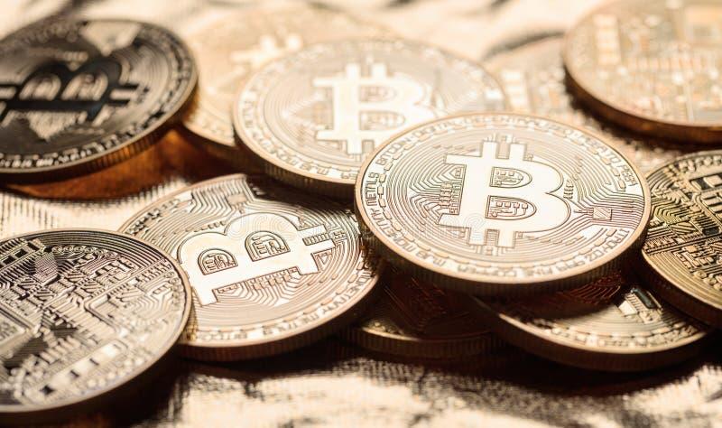 Golden shining bitcoins background stock image
