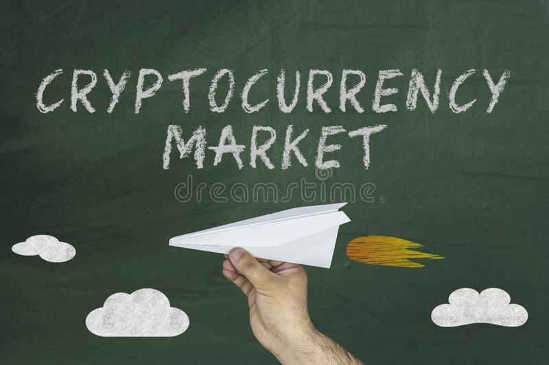 Cryptocurrency market boosting concept. man holding paper plane stock photo