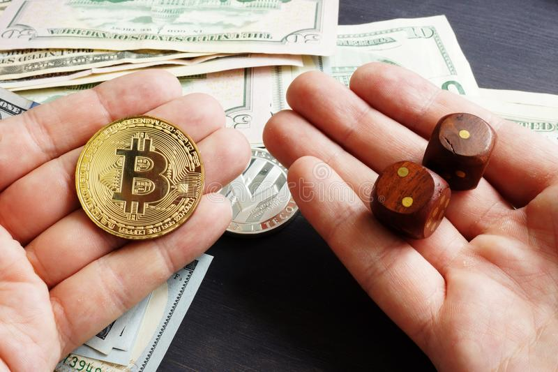 Cryptocurrency market. Man is holding Bitcoin and dices. Crypto stock exchange. Cryptocurrency market. Man is holding Bitcoin and dices. Crypto stock exchange royalty free stock photo