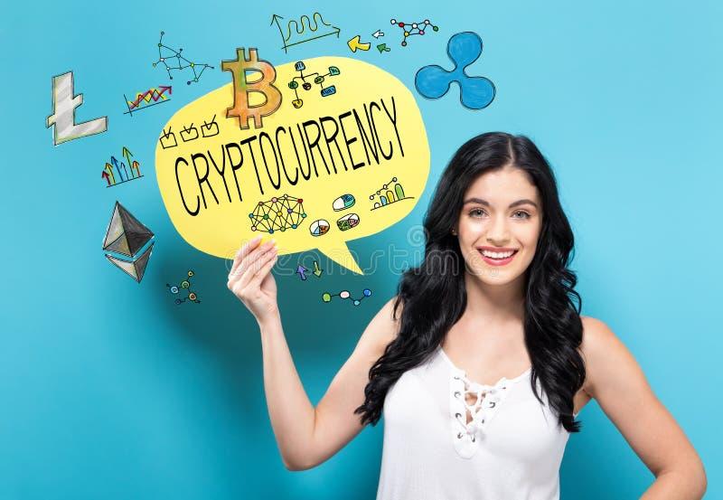 Cryptocurrency med kvinnan som rymmer en anförandebubbla arkivfoto