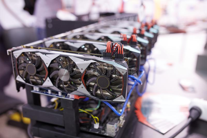 Cryptocurrency mining equipment - lots of gpu cards on mainboard royalty free stock images