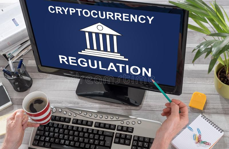 Cryptocurrency regulation concept on a computer stock photo