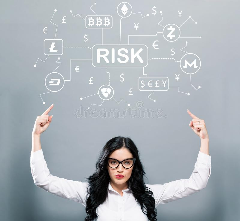 Cryptocurrency risk theme with business woman pointing upwards stock photo