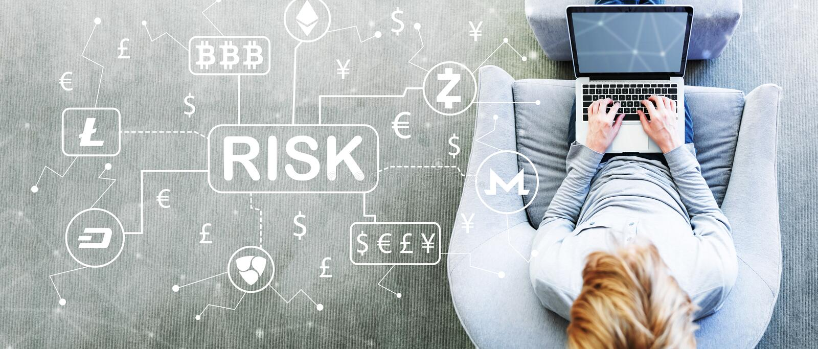 Cryptocurrency Risk Theme with man using a laptop. In a modern gray chair stock image