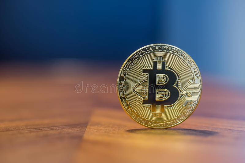 Cryptocurrency electronic sign Bitcoin with background copy space. Cryptocurrency symbol electronic sign, focus on gold metal Bitcoin stack on wooden table stock photos