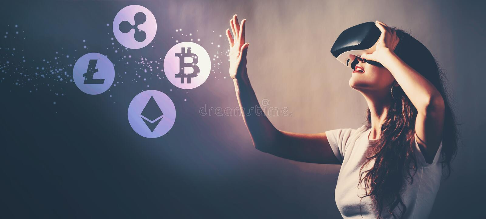 Cryptocurrency with woman using a virtual reality headset royalty free stock photography