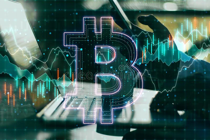 Cryptography and technology concept with businessman hand and bitcoin sign stock photography