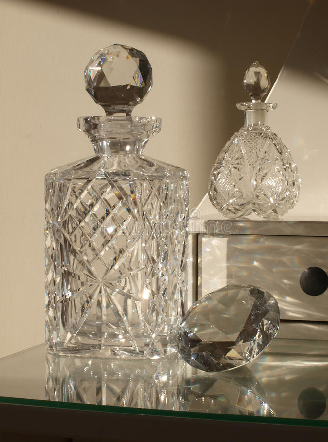 Crystal. Decanter and perfume bottles royalty free stock photo