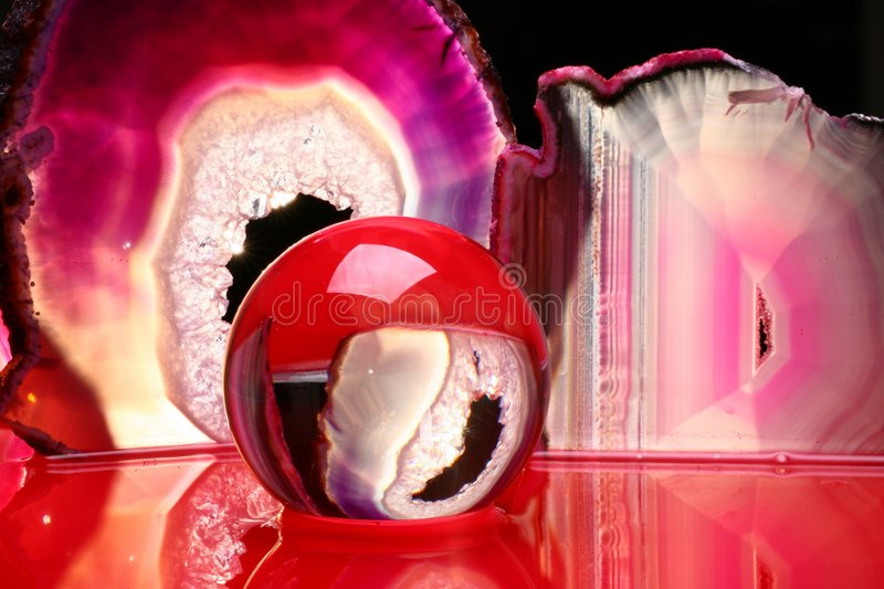 Crystal ball and agate slices royalty free stock photos