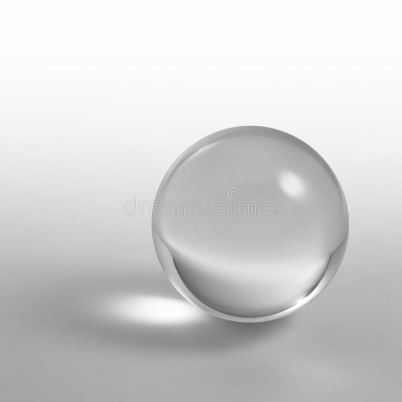 Crystal ball. A clear crystal ball and light reflections in grey gradient back stock images