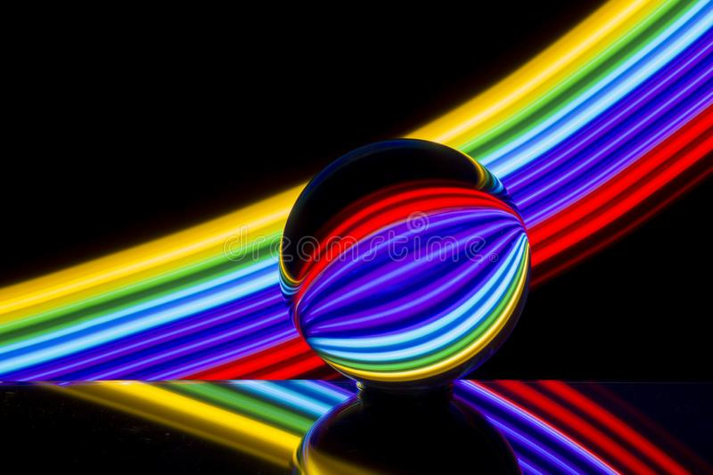 Crystal ball with colorful neon lighting behind stock photo