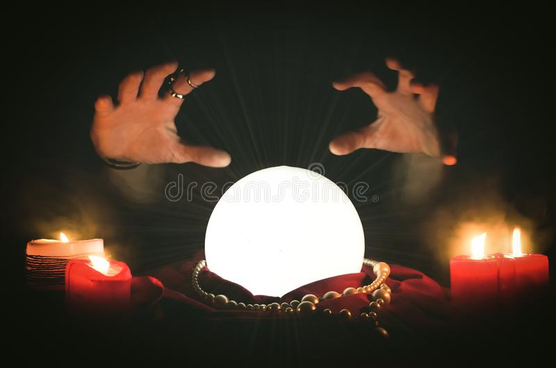 Crystal ball. Crystal ball and a fortune teller hands. Future reading concept royalty free stock image