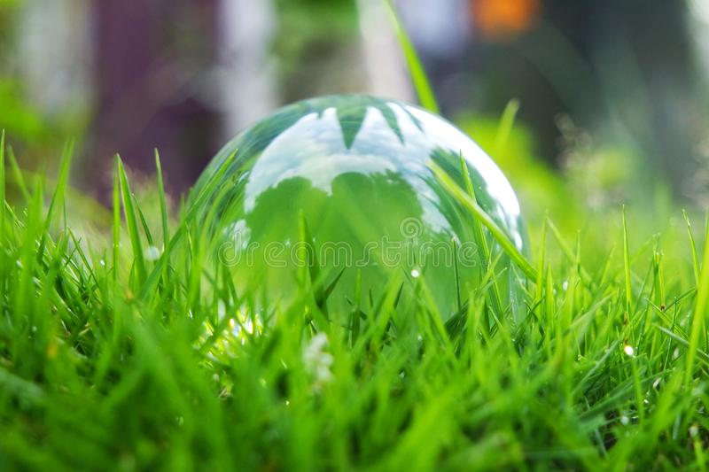 A crystal ball in the grasses stock photography