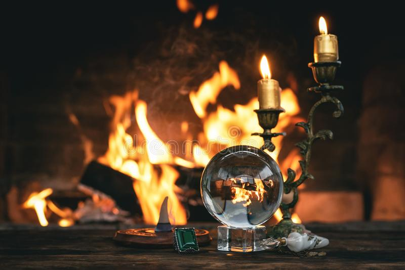 Crystal ball. Crystal ball on a magic table on a burning fire flame background, reading, future, divination, fortune, bonfire, teller, forerunner, spirit royalty free stock images