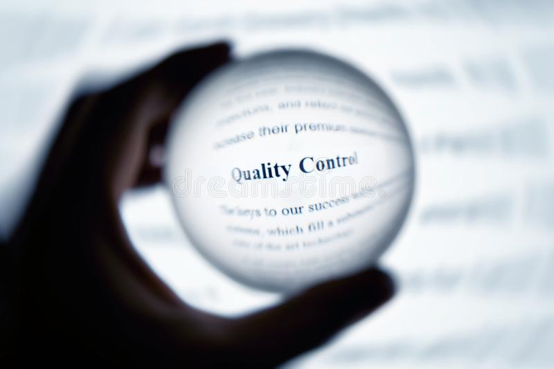 Crystal ball magnify word quality control. Crystal ball magnify computer screen word quality control royalty free stock photos