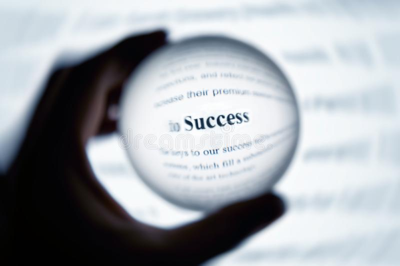 Crystal ball magnify word success. Crystal ball magnify computer screen word success stock photo