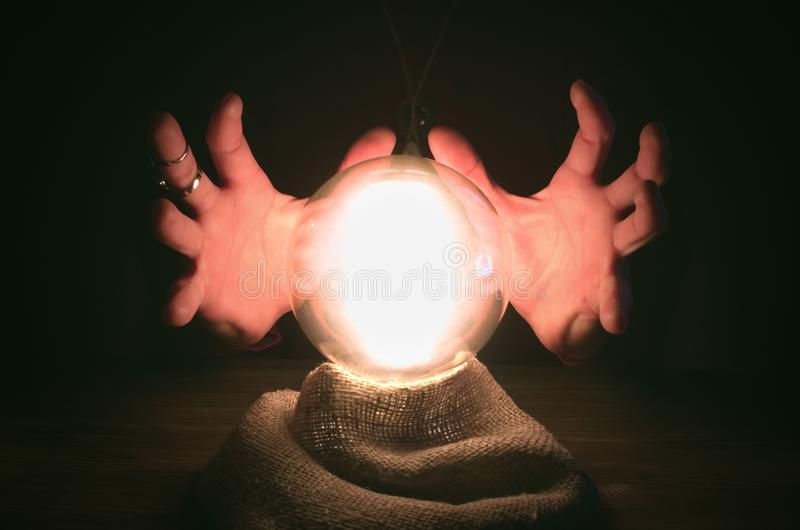 Crystal ball. The seance. Fortune teller table. Future reading. stock photos