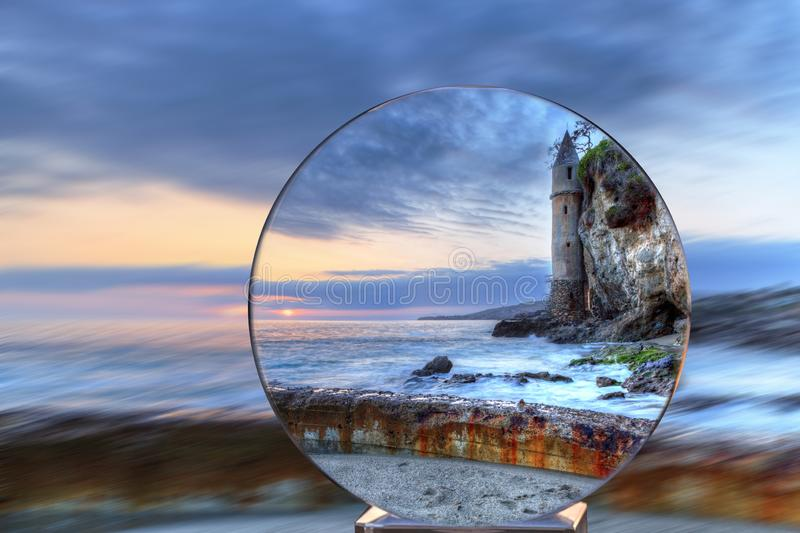 Crystal Ball Sunset over Pirates tower at Victoria Beach in Laguna Beach royalty free stock photography