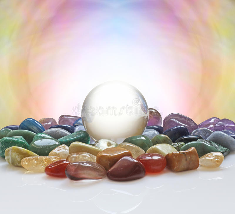 Crystal ball surrounded by healing crystals royalty free stock photos