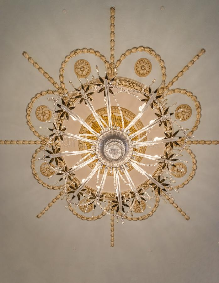 Crystal Chandelier lamp hanging from the ceiling royalty free stock image