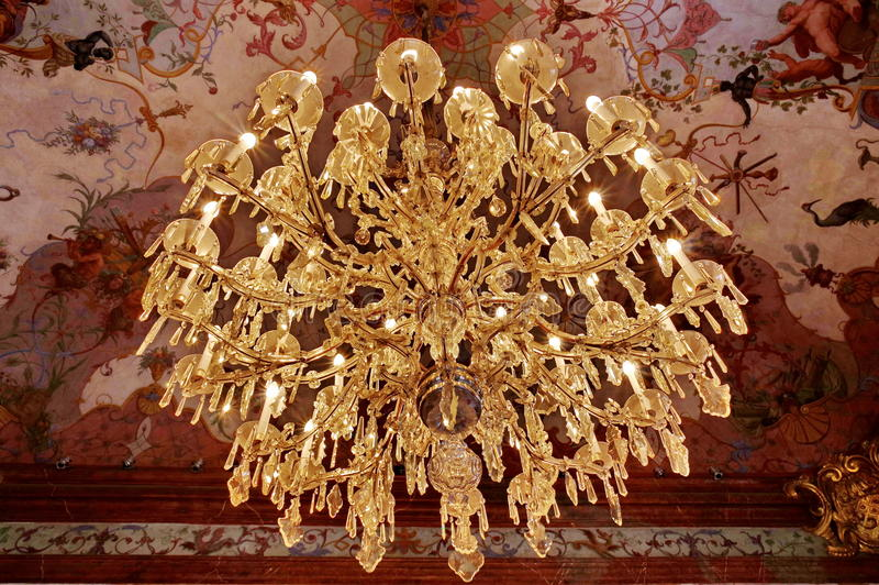 Old Crystal chandelier - Belvedere Palace, landmark attraction in Vienna - Austria. Old crystal chandelier in the ballroom at the Belvedere Palace, landmark stock photo