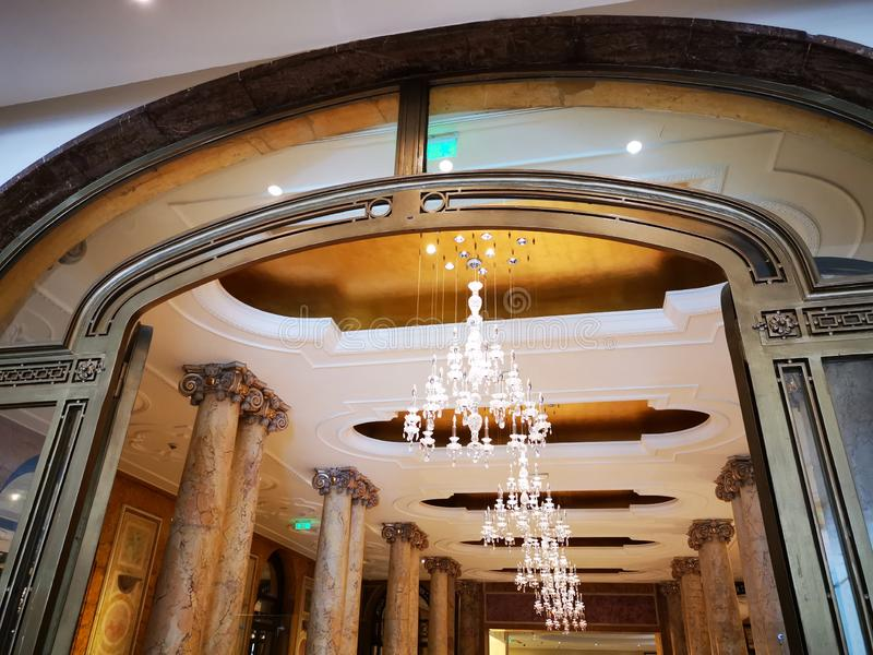 Crystal chandelier and pillars inside stock image