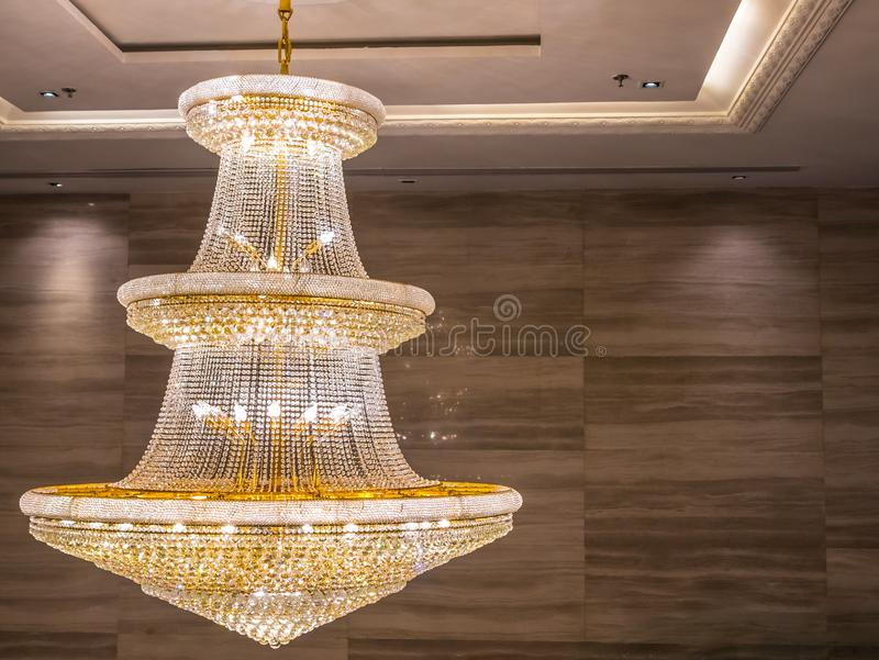 Crystal chandelier shines hanging from the ceiling in the room stock images