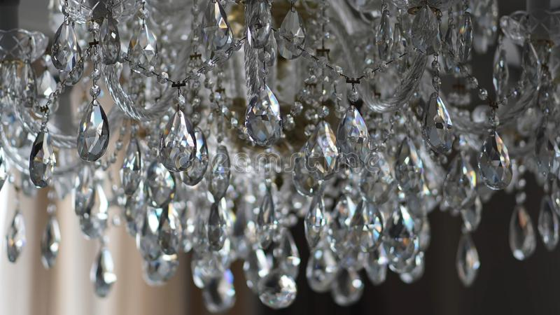 Chrystal chandelier close-up, abstract background. stock image