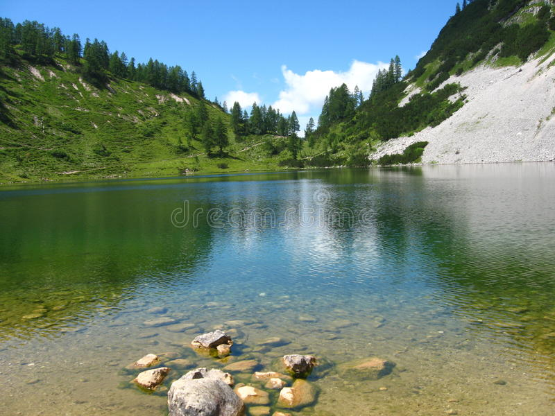 Crystal-clear alpine lake. In austria royalty free stock photo