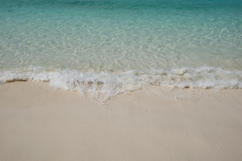 Andaman blue sea with white waving and smooth sand beach. Crystal clear Andaman blue sea with white waving and smooth sand beach in bright daylight stock photography