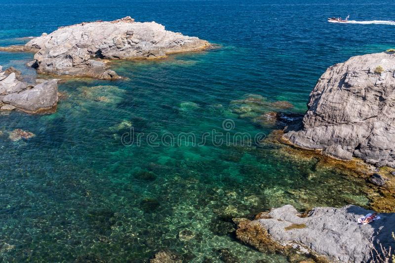 The crystal clear, aqua coloured waters off the coast of Cabo de Palos, in Murcia, Spain. It is summer and the day is sunny and hot royalty free stock photo