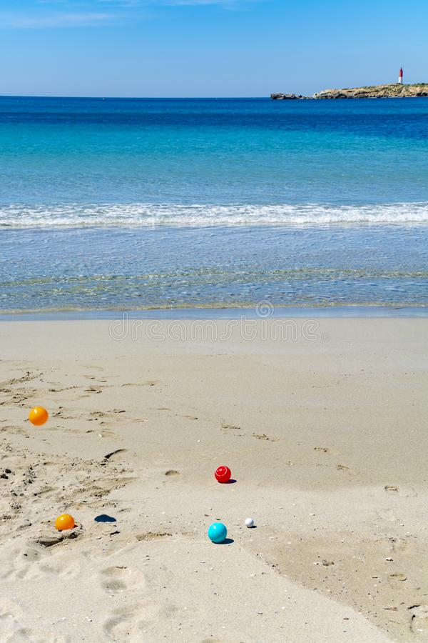Crystal clear blue Mediterranean sea water on St.Croix Martigues beach and kids beach toys, Provence, France. Crystal clear blue water of  Mediterranean sea on stock image