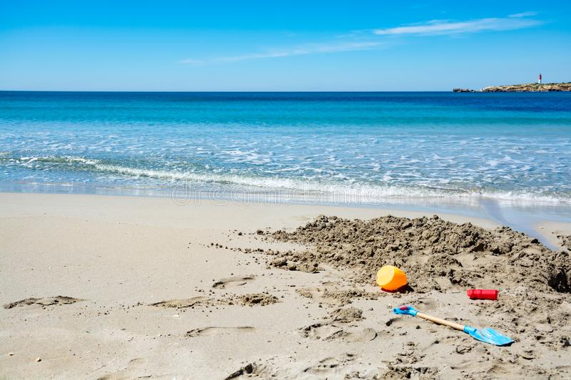 Crystal clear blue Mediterranean sea water on St.Croix Martigues beach and kids beach toys, Provence, France. Crystal clear blue water of  Mediterranean sea on royalty free stock photography