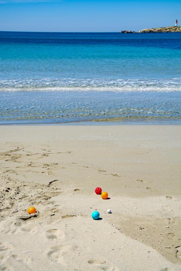 Crystal clear blue Mediterranean sea water on St.Croix Martigues beach and kids beach toys, Provence, France. Crystal clear blue water of  Mediterranean sea on stock images