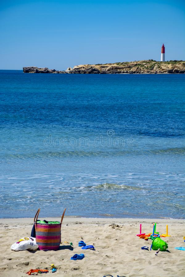 Crystal clear blue Mediterranean sea water on St.Croix Martigues beach and kids beach toys, Provence, France. Crystal clear blue water of  Mediterranean sea on royalty free stock image