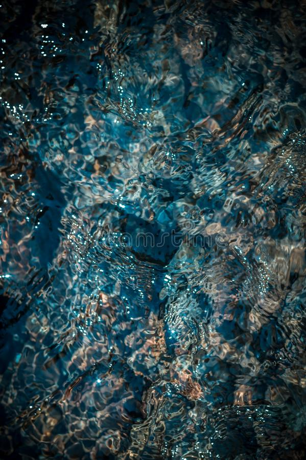 Crystal clear blue water in a mountain stream. A photo from the top of the detail. Top view. Crystal clear blue water in mountain stream. A photo from the top royalty free stock images