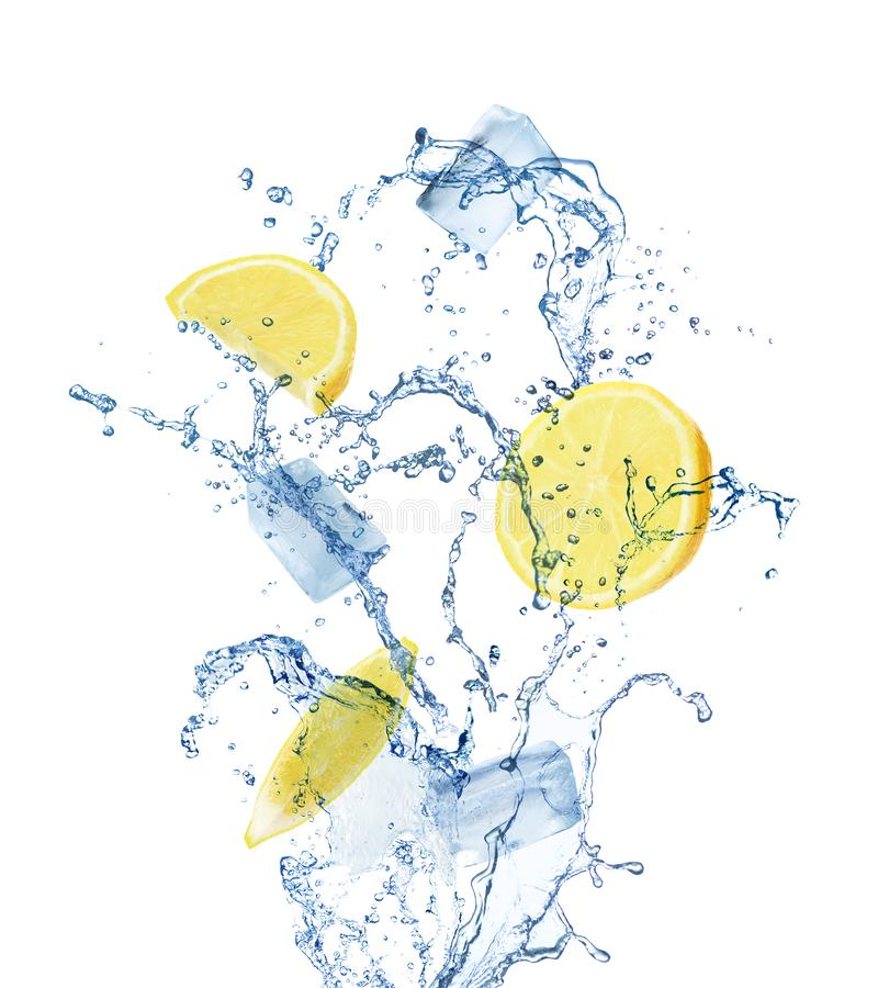 Crystal clear ice cubes, lemon and splashing water on background royalty free stock images