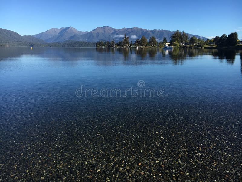 Crystal clear lake peace mind calm. Crystal clear lake royalty free stock photos