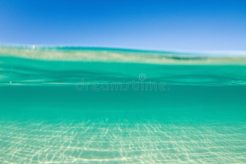 Crystal Clear turquoise water. Over under split photography royalty free stock photography