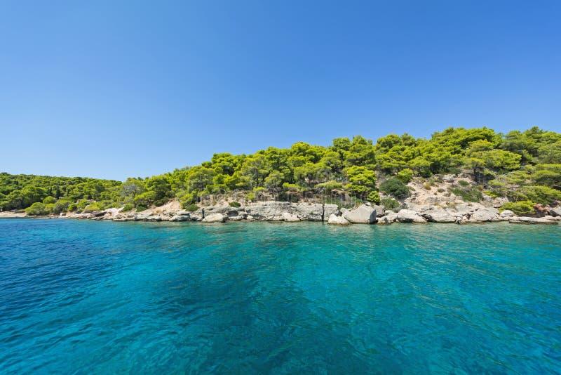 Crystal clear water in a calm Bay arkivbilder