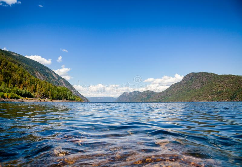 Crystal clear water of Lake Tinn Telemark Norway. Crystal clear water of Lake Tinnsja Tinn, Tinnsjo or Tinnsjoen in Telemark County, Norway, one of the largest royalty free stock photo